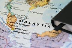 Личные примечания путешественника планируя отключение к Малайзии Стоковые Изображения RF