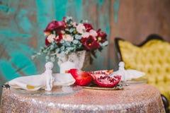 Лилии Calla и гранатовое дерево стоковые изображения
