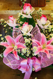 Лилия и розы. Стоковое Фото