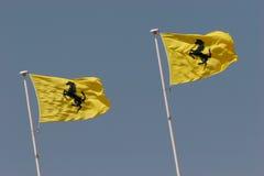 Логос Ferrari на желтом флаге Стоковые Изображения RF