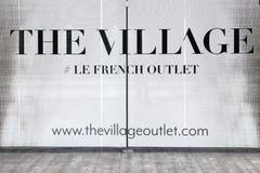 Логотип деревни на стене Стоковые Фото