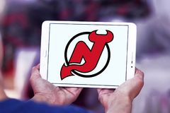 Логотип команды хоккея на льде дьяволов Нью-Джерси стоковые фотографии rf