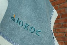 Логотип нефтяной компании Yukos на одеяле стоковые изображения