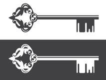 Логотип недвижимости украсил ключ Стоковые Фотографии RF