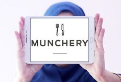 Логотип онлайн еды Munchery приказывая Стоковое фото RF
