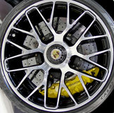 Логотип Порше на колесах Стоковое фото RF