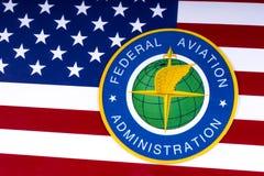 Логотип федерального управления гражданской авиации и флаг США Стоковое Изображение