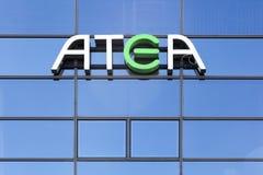 Логотип Atea на стене Стоковая Фотография