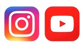 Логотип Instagram новые и значок Youtube напечатали на белой бумаге