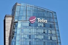 Логотип Telia на здании стоковая фотография