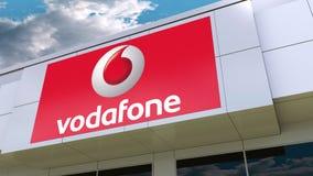 Логотип Vodafone на современном фасаде здания Редакционный перевод 3D иллюстрация штока