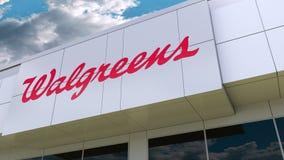 Логотип Walgreens на современном фасаде здания Редакционный перевод 3D видеоматериал