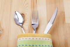 Ложка, вилка, нож с скатертью Стоковые Изображения