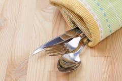 Ложка, вилка, нож с скатертью Стоковое Изображение