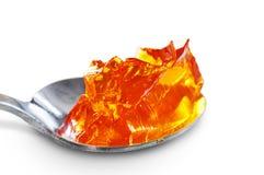 Ложка вполне оранжевого студня стоковые фотографии rf