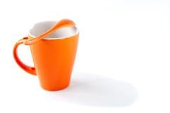 ложка померанца чашки Стоковое фото RF