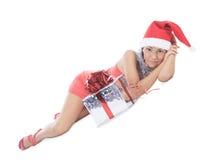 Ложь женщины Санты с подарочной коробкой Стоковая Фотография RF