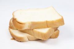 Ломоть хлеба на деревянной плите Стоковое фото RF
