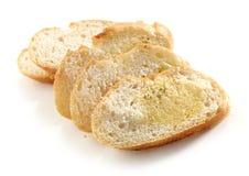 Ломтики хлеба с маслом травы стоковое изображение rf