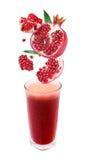 ломтики pomegranate j стекла падения свежие Стоковое Изображение