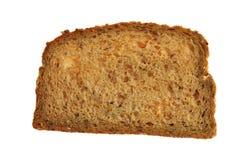 ломтик зерна хлеба весь стоковая фотография rf