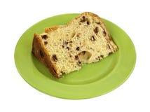 Ломтик хлеба кулича на зеленой плите Стоковое фото RF