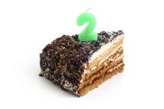 ломтик 2 номера шоколада свечки торта Стоковые Фотографии RF