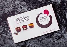 ЛОНДОН, ВЕЛИКОБРИТАНИЯ - 22-ОЕ МАРТА 2018: Коробка собрания десерта конфет шоколада ` s Brien ` лилии o на черном бетоне Стоковая Фотография