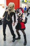 ЛОНДОН, ВЕЛИКОБРИТАНИЯ - 26-ОЕ ОКТЯБРЯ: Cosplayers одело как Harley Quinn a стоковая фотография