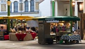 ЛОНДОН - 9-ое апреля 2014: Рынок города оптом и в розницу Стоковое Изображение