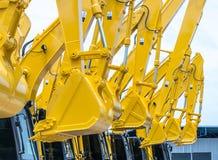 лопаткоулавливатели желтого backhoe стоковое изображение