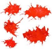 Лоснистый сияющий красный брызгать краски Стоковые Изображения
