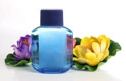 Лосьон и цветок Стоковая Фотография