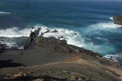 Лос Hervideros в острове Лансароте в Канарских островах Стоковые Фотографии RF