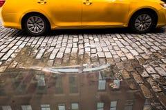 Лужица булыжника такси Стоковое Изображение