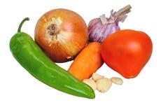 Луки, чеснок, моркови, томат, горящий перец изолированный на белой предпосылке Стоковые Фотографии RF