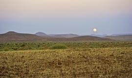 Луна поднимая в Kaokoland Стоковая Фотография RF