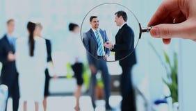 Лупа и бизнесмен в фокусе стоковые изображения rf