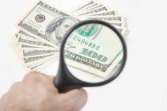 Лупа на американских долларах Стоковое фото RF