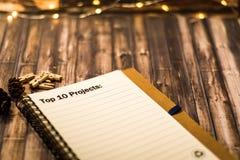 10 лучших проектирует на тетради как мотивационная концепция дела Стоковая Фотография RF