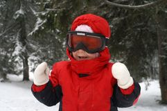 лыжа ребенка смеясь над Стоковые Изображения RF