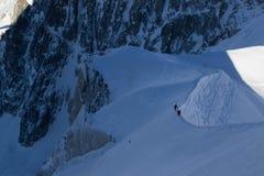 Лыжники на Aiguille du Midi, Шамони Стоковое Изображение RF