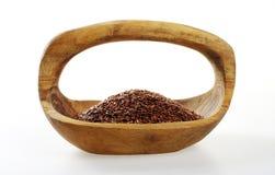 Льняное семя в деревянном шаре Стоковая Фотография