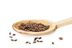 Льняное семя на деревянной ложке Стоковая Фотография RF