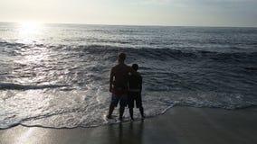 Любовники на пляже Стоковое Фото