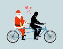 Любовник рождества Санта Клаус на велосипеде Любовники задействовать человек Стоковая Фотография RF