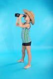 Любознательный мальчик смотря через бинокли Стоковые Фото