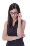 Любопытная молодая бизнес-леди смотря детали. стоковое фото