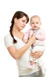 Любящая мать держа ребёнок изолировано Стоковое Изображение