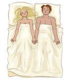 Любящие пары лежа в кровати Стоковое Изображение